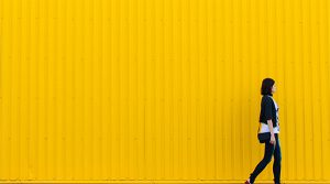 woman against yellow wall - Cecilia Unlimited blog