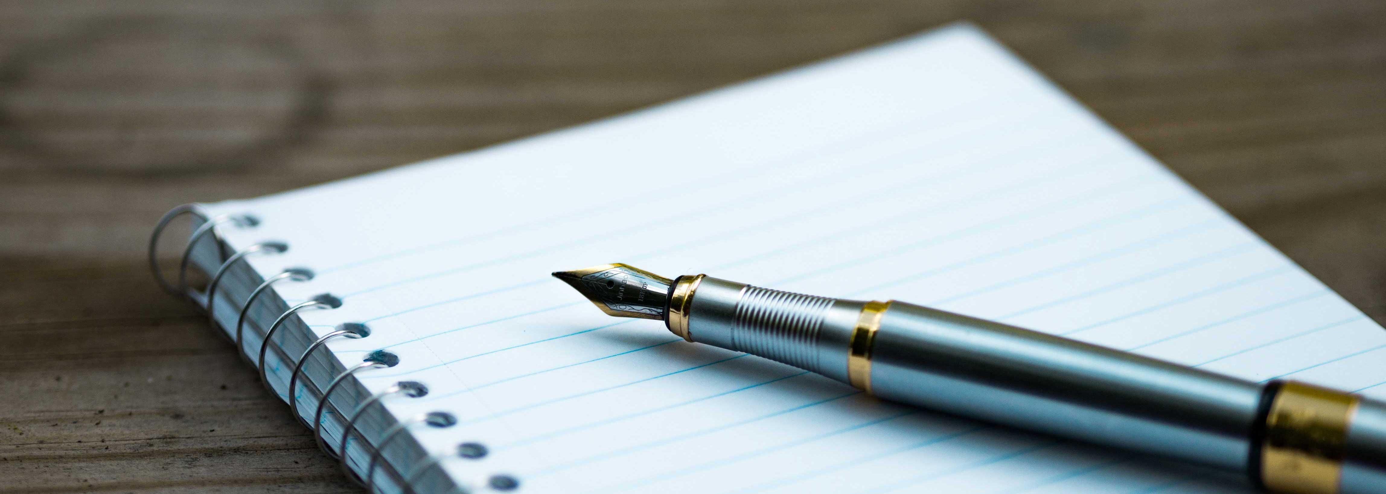 Pen and notebook to represent content strategy at Cecilia Unlimited