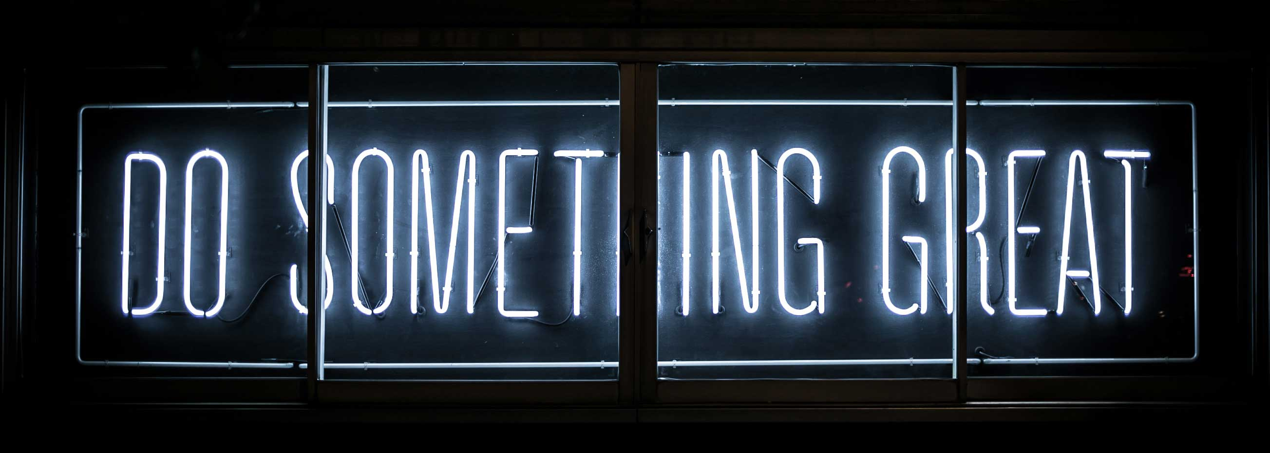 Neon sign saying 'do something great' on strategy and vision page - Cecilia Unlimited