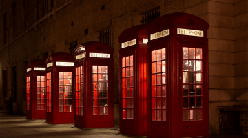 Four red phone boxes - change communications Cecilia Unlimited